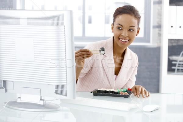 Mujer de negocios sushi comer escritorio Foto stock © nyul