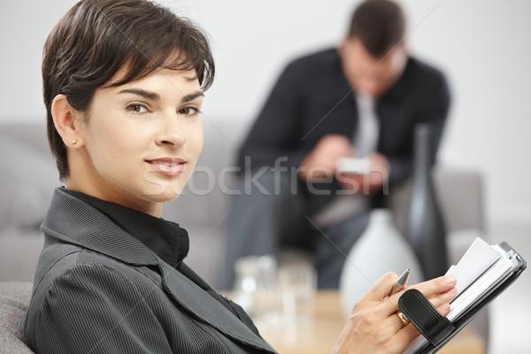 Businesswoman with personal organizer Stock photo © nyul
