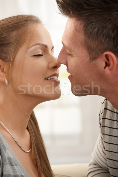 Smiling man kissing woman Stock photo © nyul