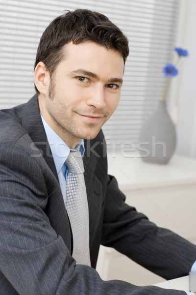 Smiling young businessman Stock photo © nyul