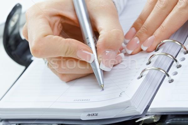 Female hand writing notes Stock photo © nyul