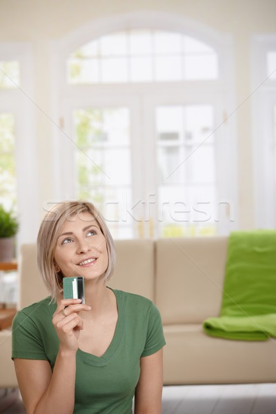 Stock photo: Woman dreaming with credit card in hand