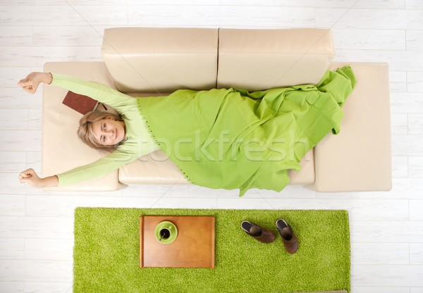 Woman stretching on couch Stock photo © nyul