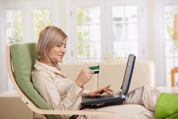 Woman using credit card on Internet.  Stock photo © nyul