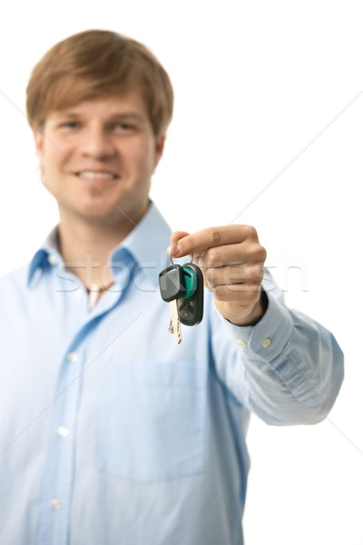 Young man handing over ignition keys Stock photo © nyul