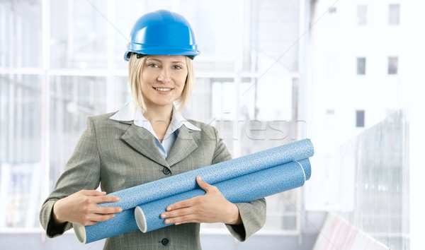 Happy architect woman with work plan Stock photo © nyul