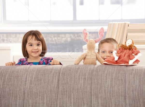 Kids standing behind sofa Stock photo © nyul
