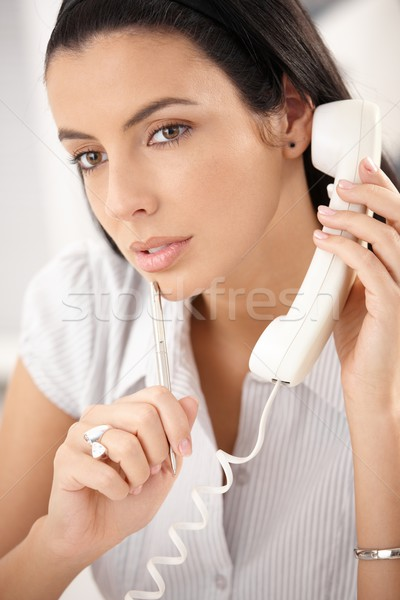 Woman concentrating on call Stock photo © nyul