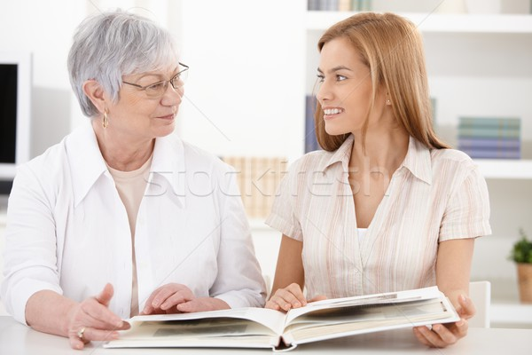 Stock photo: Young woman and grandmother having fun
