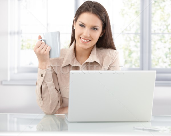 Happy woman browsing internet at home Stock photo © nyul