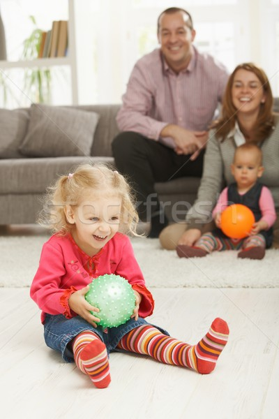 Smiling little girl with ball Stock photo © nyul