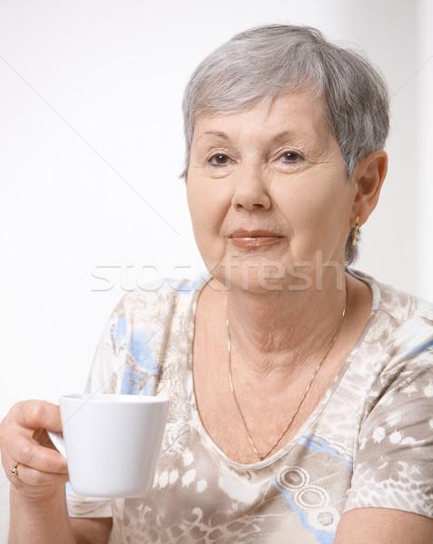 Stock photo: Senior woman drinking tea