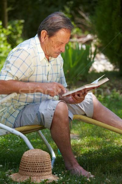 Aged man reading book Stock photo © nyul