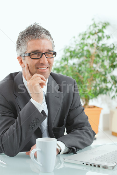 Businessman thinking at desk Stock photo © nyul