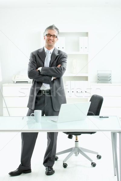 Satisfied businessman Stock photo © nyul