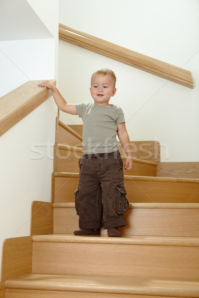 Little boy standing on stairs Stock photo © nyul