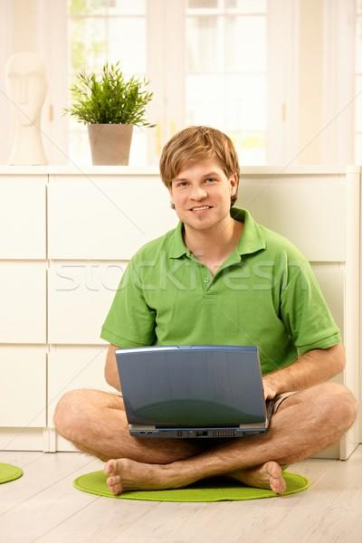 Stock photo: Man using laptop