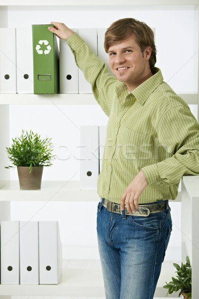 Young man in green office Stock photo © nyul