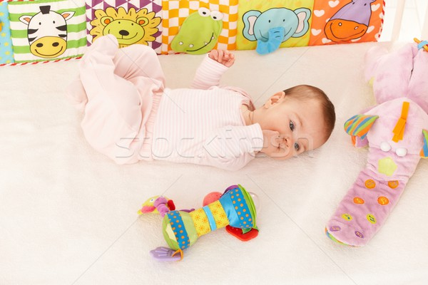 Stock photo: Baby girl looking at colorful toy