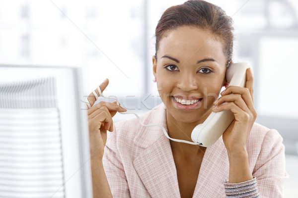 Ethnic businesswoman on landline call Stock photo © nyul