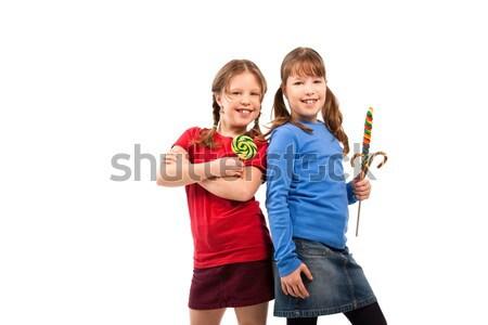 Lányok nyalóka póz alapfokú kor iskolás lányok Stock fotó © nyul