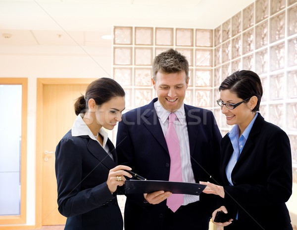 Businesspeople reviewing documents Stock photo © nyul