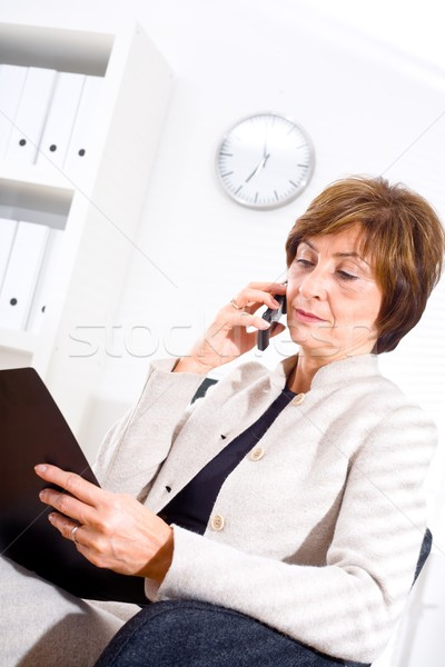 Businesswoman calling on phone Stock photo © nyul