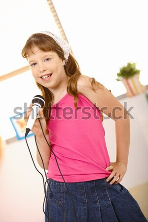Portrait of schoolgirl singer Stock photo © nyul