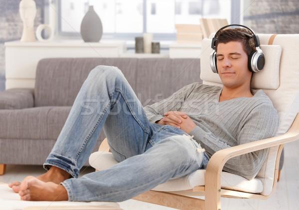 Handsome guy enjoying music on headphones Stock photo © nyul