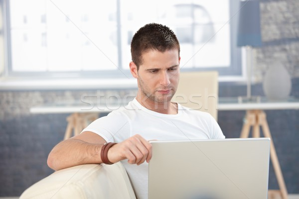 Young man working at home on laptop Stock photo © nyul