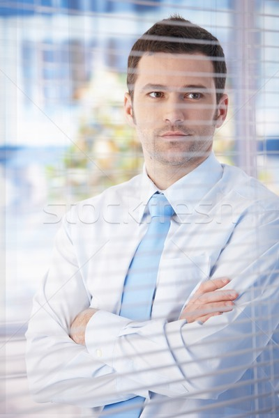 Portrait of young businessman in office Stock photo © nyul