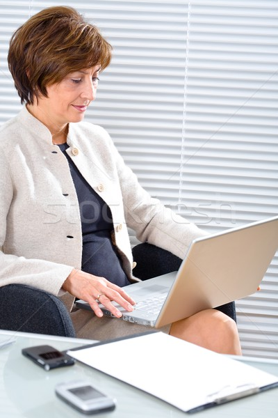 Senior businesswoman with laptop Stock photo © nyul