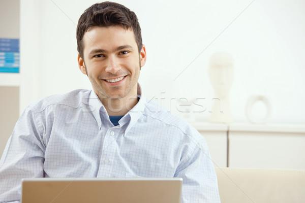 Happy man using laptop Stock photo © nyul