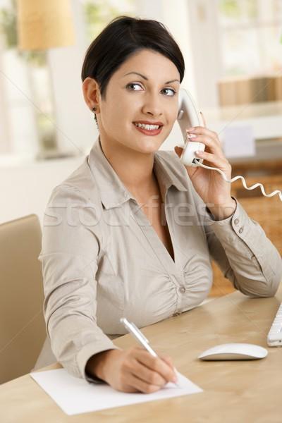 Stock fotó: üzletasszony · jegyzetel · boldog · dolgozik · asztal · iroda