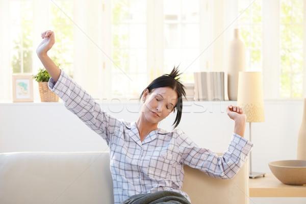 красивая женщина сидят диване ярко утра Сток-фото © nyul