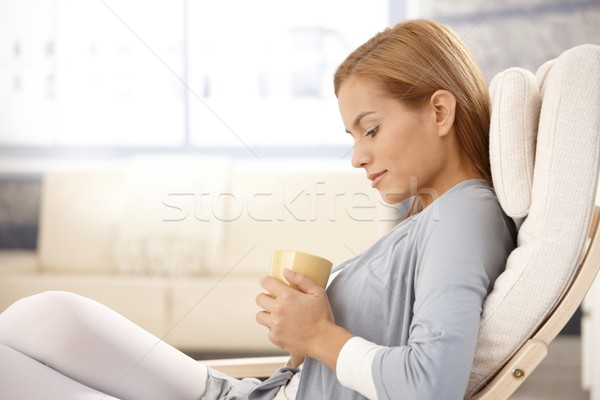 Portrait of daydreaming woman with tea cup Stock photo © nyul