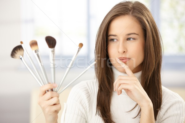 Attractive woman with makeup brush Stock photo © nyul