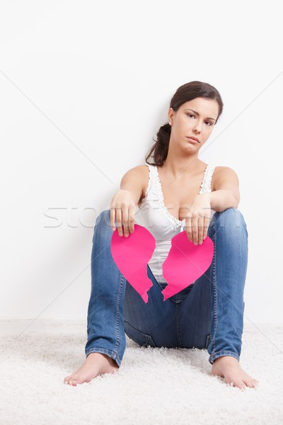 Heart-broken female sitting on floor sadly Stock photo © nyul
