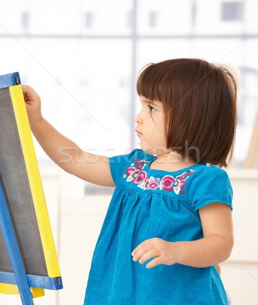 Bonitinho little girl desenho jogar prancheta menina Foto stock © nyul