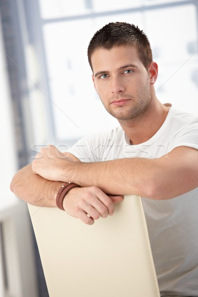 Handsome man sitting conversely on chair Stock photo © nyul
