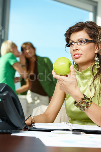 Stock photo: Businesswoman holding apple