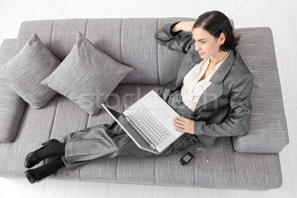 Stock photo: Businesswoman sitting on sofa