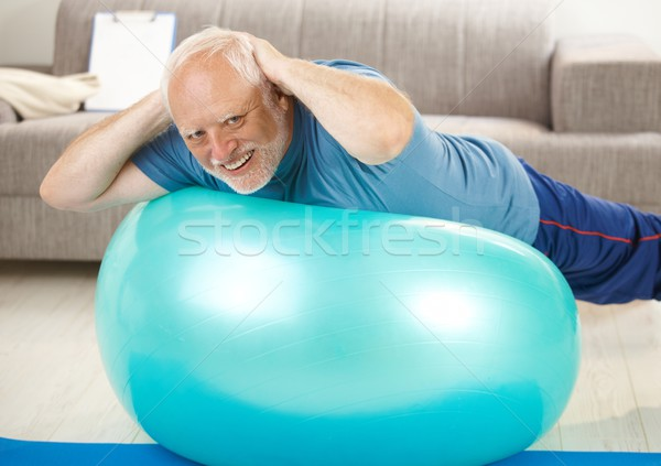 Active senior doing exercises on gym ball Stock photo © nyul
