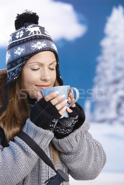 Pretty girl drinking hot tea in winter eyes closed Stock photo © nyul