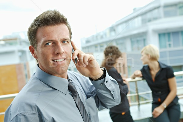 Stock photo: Businessman using mobile phone