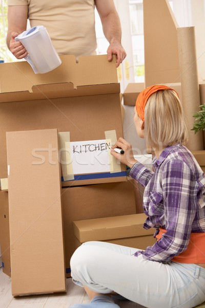 Stock photo: Couple packing for moving