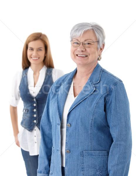 Modern mature lady smiling happily Stock photo © nyul