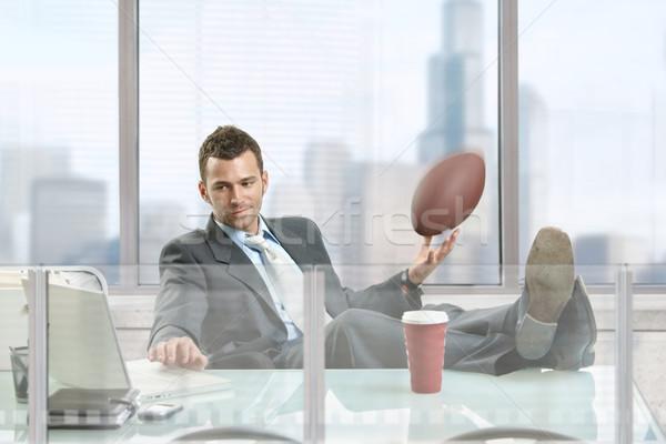 Businessman with football Stock photo © nyul