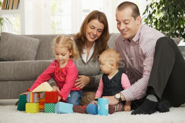 Gelukkig gezin baby vier spelen vloer Stockfoto © nyul