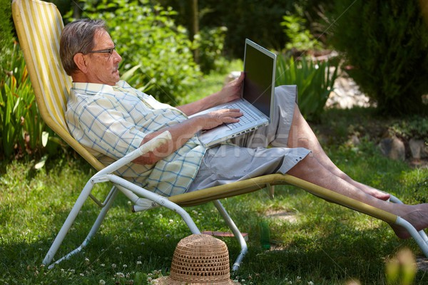 Stock photo: Senior man using laptop outdoor